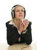Usinesswoman taking an audio course Stock Image
