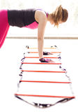 Using agility ladder. Woman using agility ladder in the fitness class stock photo