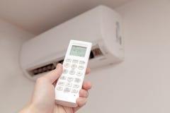 Using air conditioner Stock Photo