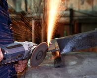 Using an angle grinder. Stock Images