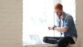 Using Apps in Smartwatch while Sitting in Window Relax Man. Creative designer , businessman stock footage