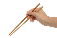 Using bamboo chopsticks with hand Stock Photo