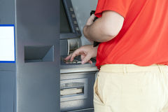 Using bank Atm. Man's hand  dialing pin on bank ATM keyboard Stock Image