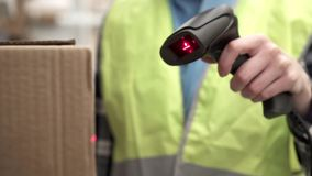 Using the barcode scanner. In the warehouse stock footage
