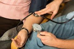 Using blood pressure meter Stock Photo