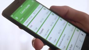 Using calorie counting app on the smartphone. Stock footage stock video