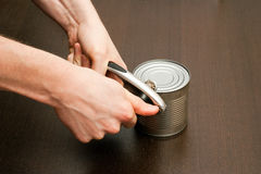 Using can-opener Stock Images