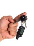 Using car alarm key Stock Photography