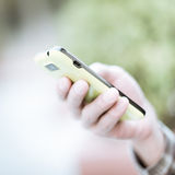 Using cell phone. On hand Royalty Free Stock Photography