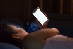 Using cell phone at night lead to blindness. Woman Using cell phone at night lead to blindness Royalty Free Stock Photos