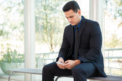 Using a cell phone at work Royalty Free Stock Images