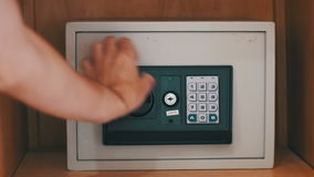 Using Code Modern Safe. Using Code Safe. Man Hand Opened Safe. The man opens the code safe and gets out his valuable papers and documents. Closing The Door By stock video