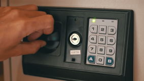 Using Code Modern Safe. Using Code Safe. Man Hand Opened Safe. The man opens the code safe and gets out his valuable papers and documents. Safe in the hotel stock video footage