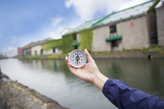 Using a compass for travelers in Otaru Japan Royalty Free Stock Photography