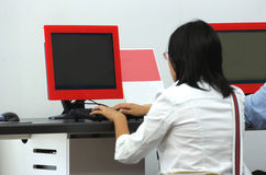 Using computer at airport. Young woman is using computer at airport royalty free stock photo
