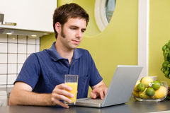 Using Computer with Juice Royalty Free Stock Photography