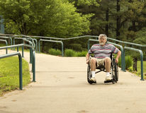 Using a concrete wheelchair access ramp Stock Photo