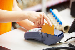 Using credit card payment terminal in shop Royalty Free Stock Image