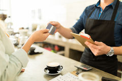 Using a credit card to buy some coffee Stock Image