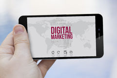 Using a 3d generated digital marketing cell phone Stock Photo
