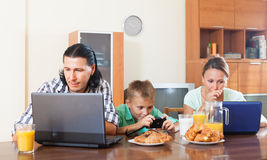 Using devices during breakfast Royalty Free Stock Image