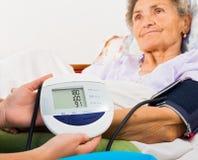Using Digital Blood Pressure Gauge Royalty Free Stock Photo