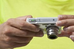 Using a digital camera. Closeup on hands holding a digital camera while reviewing pictures stock photos
