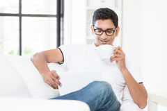 Using digital computer tablet and enjoy tea Royalty Free Stock Images