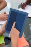 Using digital tablet in meeting Royalty Free Stock Image