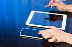 Using digital tablet and smartphone Stock Image