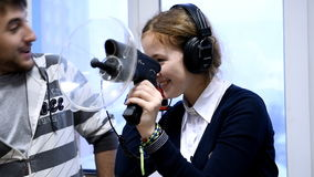 Using the directional microphone. Novosibirsk, Russia - January 15, 2015: Female student use the directional microphone in the laboratory of information security stock video footage