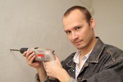 Using drill. Make repairs. Specialist makes repairs. Using drill. Make repairs Stock Photos