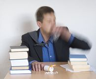 Using drugs. Businessman at the office taking pills. Blurry motion effect Stock Images
