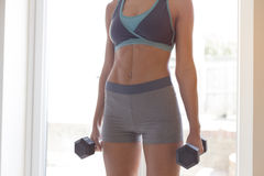 Using dumbbells at home Royalty Free Stock Photography