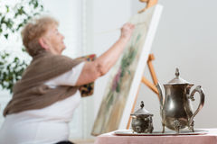 Using easel during painting Royalty Free Stock Images