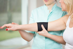 Using elbow stabilizer Royalty Free Stock Photos