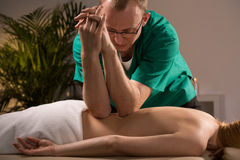 Using elbows during massage Stock Images