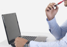 Using electric cigarette and laptop Stock Images