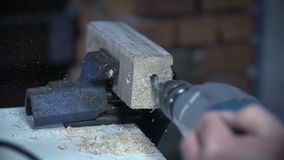 Using electric drill to make a hole in a piece of wood. Cutting, slitting and polishing metal tube with electric grinder with numerous sparkles flying around stock footage