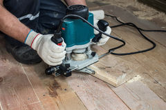 Using an electric router. For cutting wooden boards stock photography