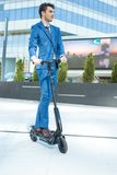 Using Electric Scooter on the street royalty free stock images