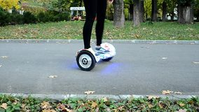 Using Electric Smart Scooter Self Balancing Hoverboard stock footage