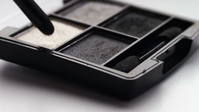 Using eye shadow palette with brush,Gray shades of eyeshadow stock video