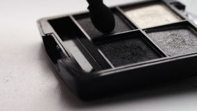 Using eye shadow palette with brush,Gray shades of eyeshadow stock footage