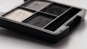 Using eye shadow palette with brush,Gray shades of eyeshadow. Gray shades of eyeshadow, Close-up view of brush running through the shadows,eye shadow palette for stock video footage