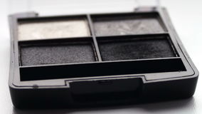 Using eye shadow palette with brush,Gray shades of eyeshadow stock video footage