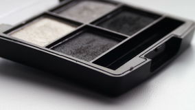 Using eye shadow palette with brush,Gray shades of eyeshadow. Gray shades of eyeshadow, Close-up view of brush running through the shadows,eye shadow palette for stock footage