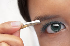 Using eyebrow tweezer Stock Photos