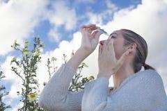 Using eyedropper to treat irritated eyes Stock Photos