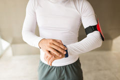 Using fitness tracker. Cropped image of sportsman using fitness tracker stock photos
